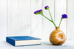 Books or journal with flowers arranged. Books or journal with flowers arranged on a neutral white painted desk stock photo
