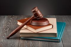 Books, judge`s gavel and sound block. Books, a judge`s gavel and a sound block on wooden table. Learning jurisprudence, juridical concept royalty free stock photography