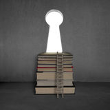 Books with key shape door on concrete wall and ladder Royalty Free Stock Photography