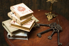 Books and keys on wooden table Stock Images