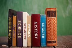 Books of knowledge. Various class books on wooden table Stock Photos