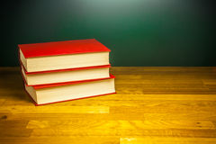 Books of knowledge on wood desk table in library Royalty Free Stock Photo