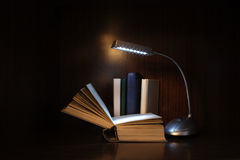Books and lamp Stock Photos