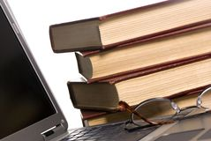 Books and laptop royalty free stock photos