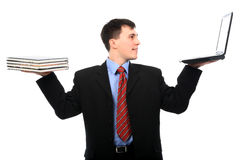 Books and laptop. Business theme: handsome businessman holding books and a laptop royalty free stock photos