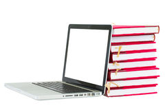 Books and laptop with copy space on screen Royalty Free Stock Photo