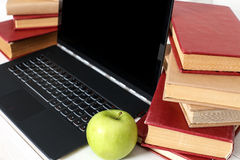 Books with laptop Royalty Free Stock Image
