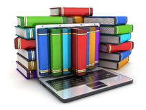 Books and laptop Stock Image