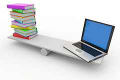 Books and laptop on scales Stock Image