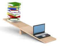 Books and laptop on scales. Royalty Free Stock Photography