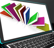 Books On Laptop Shows Research Royalty Free Stock Image