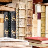 Books in a row background. royalty free stock photo