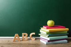 Free Books, Letters And Apple On Wooden Table Near Chalkboard, Space For Text. Teacher`s Day Royalty Free Stock Photo - 160385415
