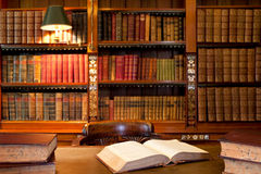 Books at the library. A collection of books and a desk at a library or office Stock Image