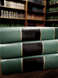 Books in Library. Close up of several volumes of books on a table in library Royalty Free Stock Photos