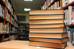 Books in library. Background in front of bookshelves Royalty Free Stock Photography
