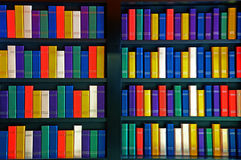 Books on library shelves. Colorful books on library shelves Stock Images