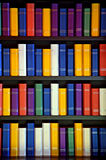 Books on library shelves. Colorful books on library shelves royalty free stock photo
