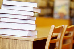 Books on a library table Stock Image