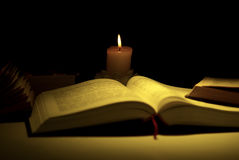 Books by the light of candle Stock Image