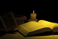 Books by the light of candle Stock Photography