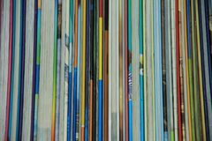 Books in different colours in the library. The books in line in different striking colours for rent in the municipal library, Boekenberg in the city Spijkenisse Stock Photos