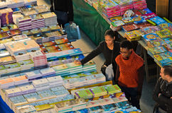 Books. LISBON, PORTUGAL - DECEMBER 5, 2013: Some potential buyers observe a Stock Images
