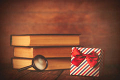 Books with loupe and gift box Royalty Free Stock Photos