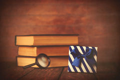 Books with loupe and gift box Stock Image