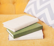 Books on Luxury yellow sofa Royalty Free Stock Images