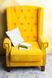 Books on Luxury yellow sofa Stock Photos