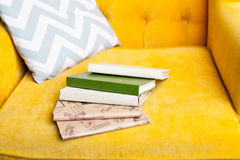 Books on Luxury yellow sofa Stock Images