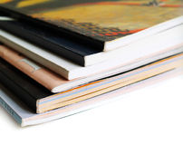 Books and magazines. Stack of magazines on white background Royalty Free Stock Images