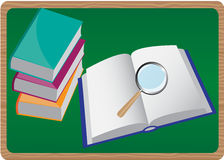 Books and magnifying glass Stock Photos