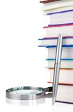 Books and magnifying glass isolated on white Stock Image