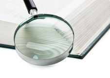 Books and magnifying glass Stock Photo