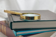 Books, magnifying glass Royalty Free Stock Image