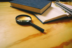 Books and magnifying glass Royalty Free Stock Photo