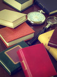 Books, magnifying glass and watch. Royalty Free Stock Photo