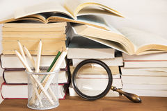Books and the magnifying glass Stock Photography