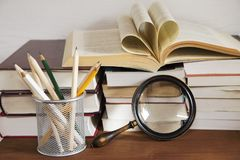 Books and the magnifying glass stock photos