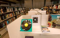 Books about music and vinyl cultur inside the new public library De Krook. GHENT, BELGIUM - MAR 30, 2018: Books about music, sound and vinyl cultur inside the Royalty Free Stock Photo