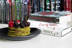 Books Near Cake on Plate Royalty Free Stock Images