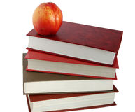 Books and nectarine. Isolated white Stock Images
