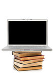 Books and new laptop Stock Images