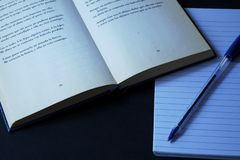 Books, Note book and pen. Close up photo of an empty note book with a blue pen on top and apoetry books stock photos