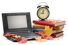 Books, Notebook, Alarm Clock And Autumn Leaves Royalty Free Stock Photo
