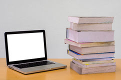 Books with Notebook (laptop) on wood table, Education, Thesis,essay Stock Photos
