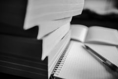 Books, notebook and pen. Note-taking. Black and white photo Stock Photos