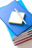 books with notepad and pen Stock Image